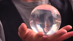 Street artist with crystal ball Stock Footage