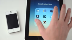 Facebook on an iPad display Stock Footage