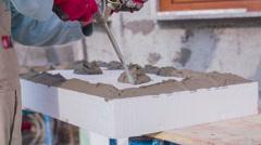 Adding propylene on Styrofoam block for wall isolation - stock footage