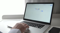 Google on macbook Stock Footage