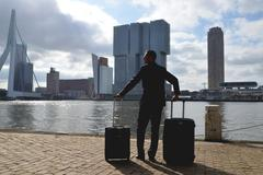 Netherlands, Rotterdam, Man arriving into city - stock photo