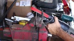 Saw Cutting Through Metal In Messy Garage Stock Footage