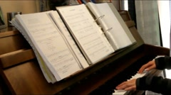 Young girl hands learning to play  the piano. No sound Stock Footage