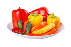 mixed hot and sweet peppers in a bowl isolated on white - stock photo