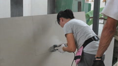 Women Using Grinder On Missions Trip Stock Footage