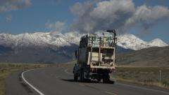 Truck traffic mountain snow capped valley HD 005 Stock Footage
