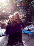 Two girls (6-7 years, 8-9 years) on trampoline with static hair Stock Photos