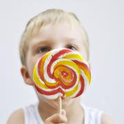 Boy with lollypop - stock photo