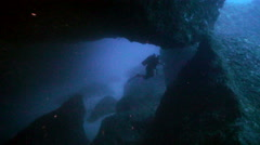 Scuba diver in huge underwater cave, mediterranean sea Stock Footage