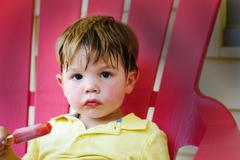 Stock Photo of Boy with ice-lolly (2-3 years)