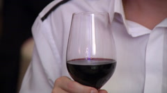Red wine in the glass, holding a man (in a frame hand only) Stock Footage