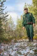 Chasseur is in his hunting grounds in autumn Stock Photos