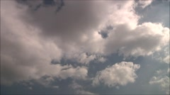 White clouds in a blue sky. Timelapse 64x Stock Footage