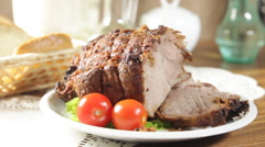 Roasted shoulder on a plate Stock Footage