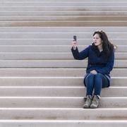 UK, Blackpool, Women taking photo on mobile phone Stock Photos