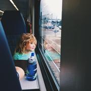 USA, Florida, Palm Beach County, West Palm Beach, Girl (2-3) in train looking - stock photo