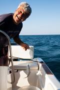 Italy, Puglia, TA, Ginosa, Marina di Ginosa, Happy Fisherman Stock Photos