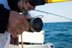 Italy, Puglia, TA, Ginosa, Marina di Ginosa, Close-up of Fishing rod - stock photo