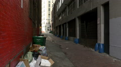 An alleyway with boxes and trash Stock Footage