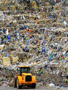 Bulldozer landfill - stock photo