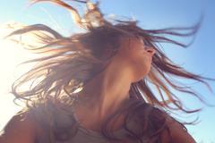 Woman tossing hair Stock Photos