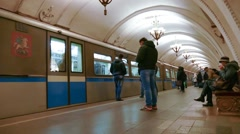 Moscow underground train stops at a platform and passengers embark and disembark Stock Footage