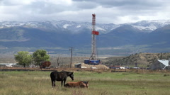 Oil exploration well rural farming community HD 013 Stock Footage