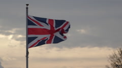 Union Jack flag against clouds - stock footage