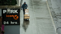 Raining FedEx Worker Man Rainy Bad Weather NYC Parking Garage 24 Hrs Delivering Stock Footage