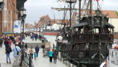 Gdansk, Poland. The Long Riverside promenade and old galleon ship - stock footage