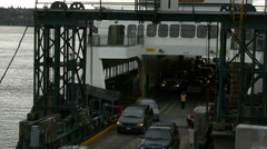 A Ferry Boat Docks In Seattle Stock Footage