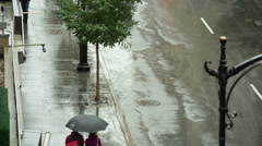 Raining People Walking Umbrellas Couple Rainy Bad Weather NYC - stock footage