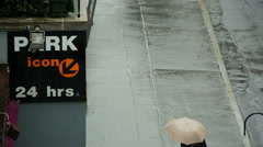 Raining People Walking Umbrellas Rainy Bad Weather NYC Parking Garage 24 Hrs Stock Footage