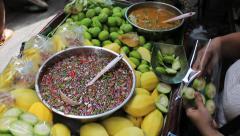 Asian Fruit Seller Preparing Mangos To Sell Stock Footage