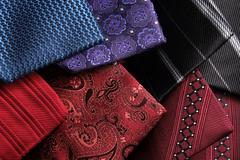 Rolled up silk ties on top of each other - stock photo