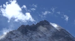 Close up of snow mountain summit and fast moving clouds Stock Footage
