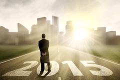 businessman looking future 2015 - stock illustration