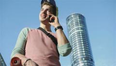 Young boy talking on his mobile phone in the big city. Stock Footage