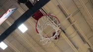 Stock Video Footage of Basketball Scores and Hits Camera - Great transition shot