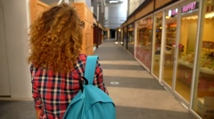 Woman Shopping in the City - Girl Walking Between Display Windows Stock Footage