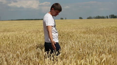 Farmer admires wheat field Stock Footage