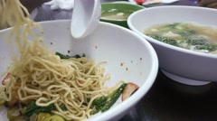 4k Ultra HD time lapse video on eating wanton noodle and wanton soup Stock Footage