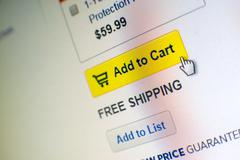 "mouse clicking ""add to cart"" button in an e-commerce website - stock photo"