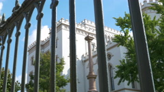 Wrought iron fence to historic state capitol building Baton Rouge LA Stock Footage