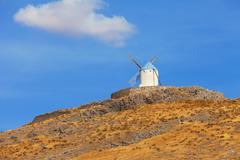 typical windmills of region of castilla la mancha - stock photo