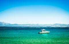 Yachts on azure sea water - stock photo