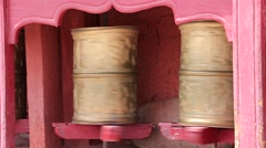 Buddhist prayer wheels in Tiksey monastery with written mantra. Leh, India - stock footage