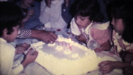 Stock Video Footage of Little Girl Blowing Out Birthday Candles-1978 Vintage 8mm film