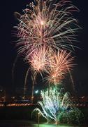 Beautiful fireworks in the night sky. - stock photo
