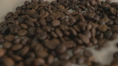 Roasted coffee beans. DOF background. Stock Footage